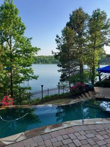 Photo for Intimate lakefront retreat with magnificent infinity pool and stunning lake view