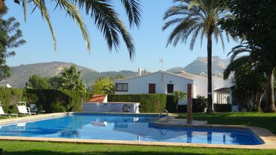 Photo for Cozy holiday home with large communal pool in quiet location, SAT TV