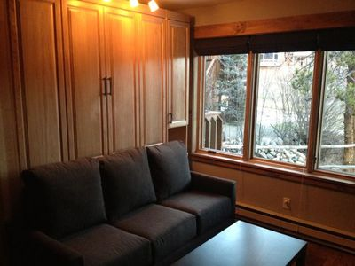Murphy bed with full-sized couch (don't have to move to deploy bed)