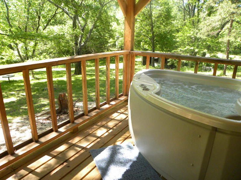 lodging cabins friendly the rentals lake tubs rent tub mo branson with in taneycomo log on for hot pet cabin missouri