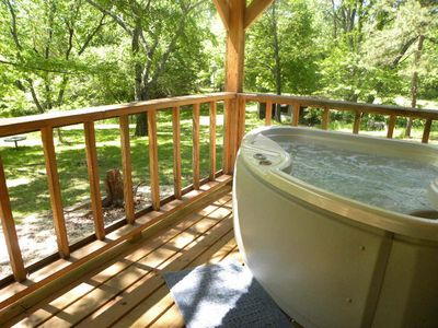 Outdoor Hot Tub to enjoy with the tree uplighting for extra ambiance