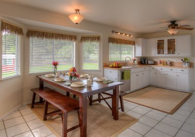 Dining Room and Kitchen with plenty of natural light.
