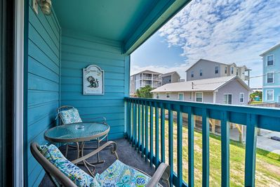Watch the sunrise from the balcony of this Carolina Beach vacation rental condo.
