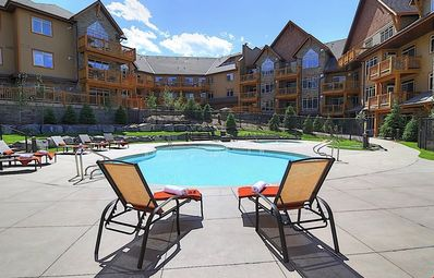 Photo for Hot Tub + Heated Outdoor Pool | Private Balcony + Beautiful Condo