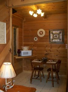 Photo for Cozy Cabin with hot tub and fireplace $99/night