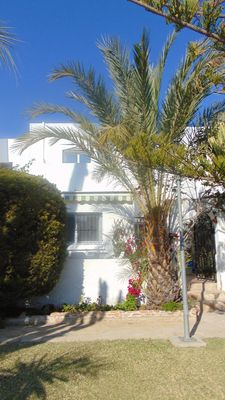 Photo for Three bed townhouse in popular complex, lush gardens, pool and Wifi