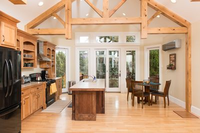 Open concept with chef kitchen and access to deck and backyard