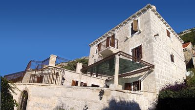 Photo for Spacious stone villa with views and private pool, walking distance to the beach