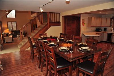 Dining room with pub style table, seating for 10.