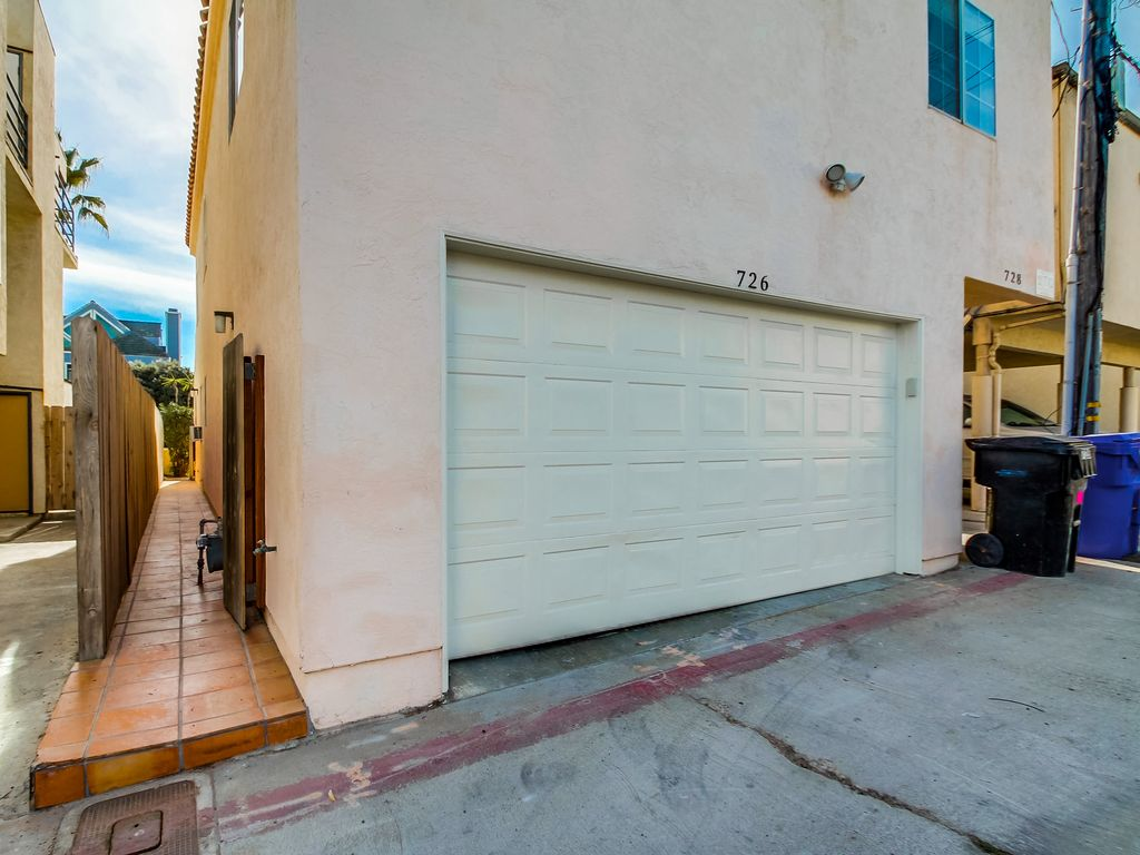 ou station doors room dog home by traditional design ac palmdale laundry image direct with shower garage washing
