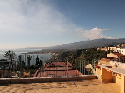 Photo for Panoramic Loft in the historic center of Taormina overlooking the sea, the city and Mount Etna.
