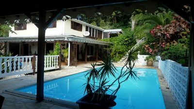 Photo for Charming studio in a tropical garden. with pool, wifi and air conditioning