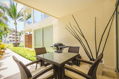 Your private patio with BBQ, table and ping pong table