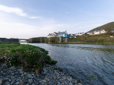 Photo for Perched on a rocky outcrop above the river Ystwyth, directly on the Wales Coastal Path, this elegant