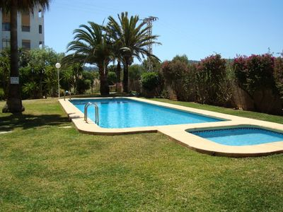Photo for At the heart of Javea's Arenal Beach this large airy apartment has it all.