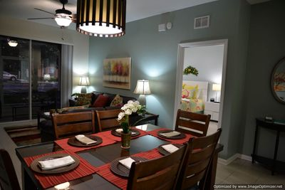 Interior living room and dining room lighting shown at dusk