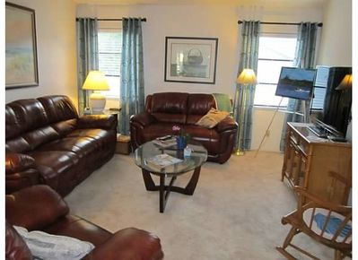 Family room with large screen TV, Stereo & 3 comfortable recliners.