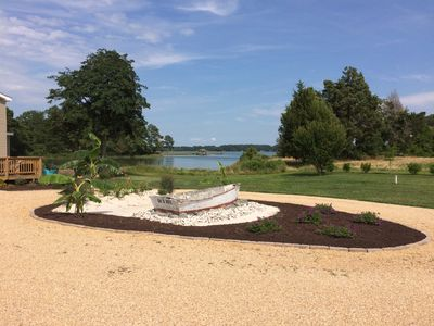 Master Gardener Richard incorporated original owner's skiff into landscaping