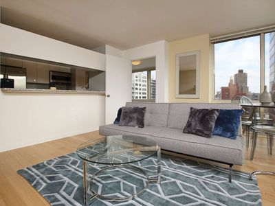 Photo for UES Luxury 2 bedroom 1.5 bath Queen Bed! Elevator/Doorman/Gym/Floor to Ceiling windows 5173