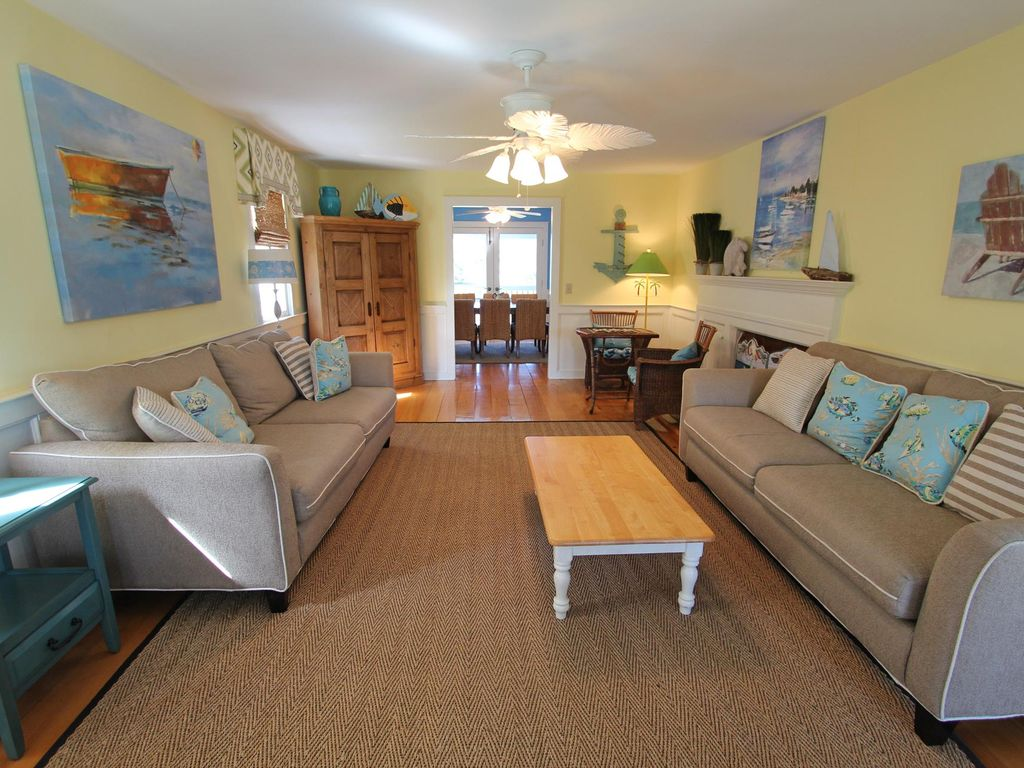 Two story classic beach home with a 2nd floor sundeck and for Sundeck flooring