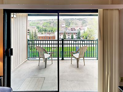 Balcony - Sliding glass doors lead to the balcony with seating for 2.