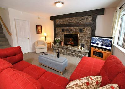 Beautiful fire place, large flat screen TV, and comfortable seating creates a space you are not going to want to leave