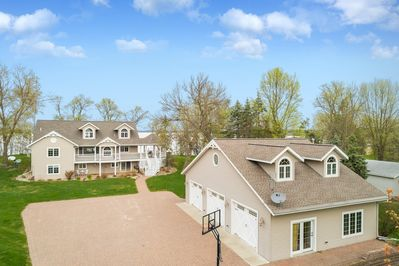 Luxury lake home with  paved driveway for parking and basketball