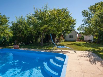 Photo for Holiday apartment with pool and garden