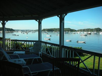 Chairs on the front veranda look out onto Phinney's Harbor