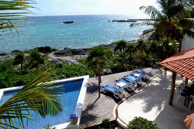 Vacation with these stunning ocean views, spacious lounge area, and pool.