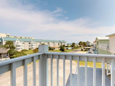 Photo for NEW LISTING! Gulf view duplex w/balcony, beach access & shared pools/hot tub/gym