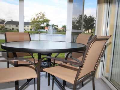Photo for Luxury Water View Gated Villa 5 miles from Disney W/ Free WIFI, Pool, Gym