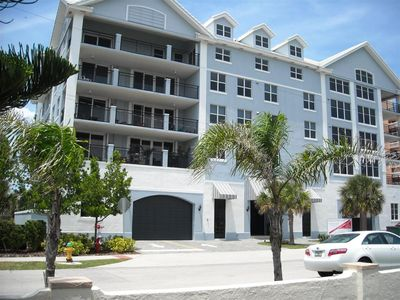 Front of Ocean Club Condo, note under building covered, secure, parking