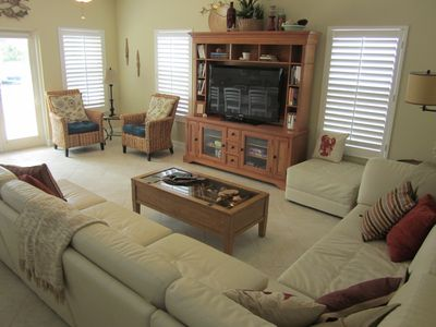 The lounge/living room with 50 inch television
