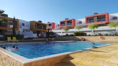 Photo for Luxury apartment with 2 bedrooms, terrace & barbecue and a pool & sea view