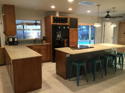 Modern but cozy kitchen with a huge island with ample seating for everyone.