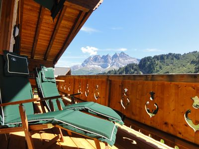 Large sunny wooden balcony with view on the mountain