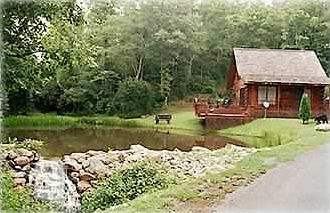 Cabin and trout pond with waterfall.