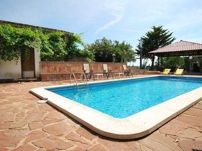 Photo for 10 bedroom Villa, sleeps 20 with Pool, Air Con and Walk to Shops