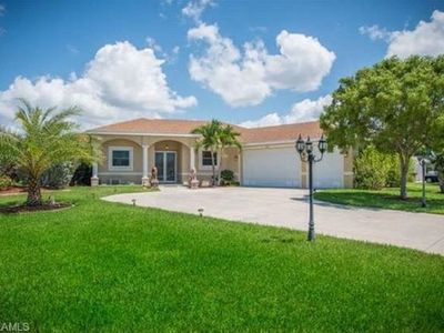 Photo for 2400 sq ft Home 4 Bedroom, 3 Bath, Pool & Spa Sleeps 11. Full kitchen Cape Coral