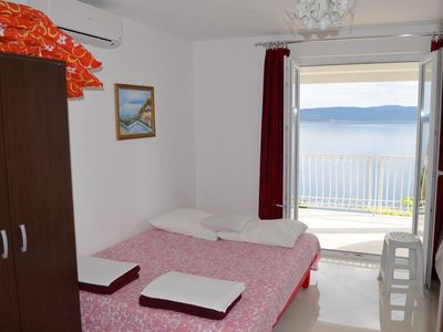 Photo for Two bedroom apartment with balcony and sea view Pisak, Omiš (A-4281-a)
