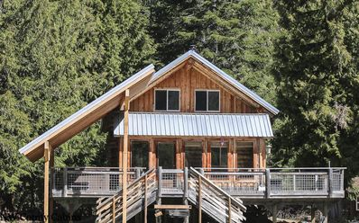 Photo for Remote Log Cabin on the White River with private beach, and hot tub and WIFI