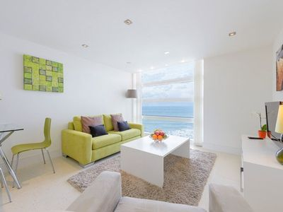 Photo for Contemporary apartment with fabulous views of Tolcarne beach in town with lift access