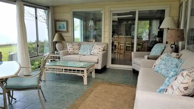 Sunroom with slider to the kitchen.