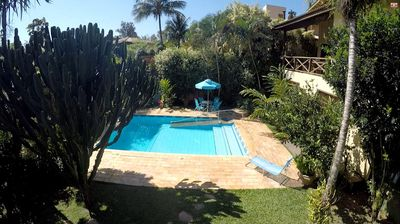Photo for Praia Feiticeira, two bedrooms with air-c, pool, barbecue, garage