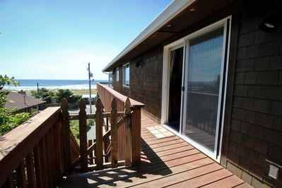 Wrap around deck with spectacular ocean and Neahkahnie Mountain views.  Stairs leading down to driveway.