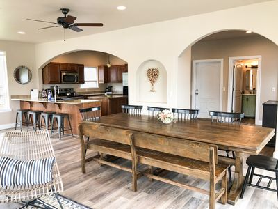 Large kitchen and bar seating. Dining table seats up to 12 people.