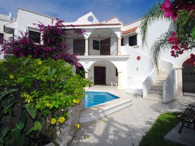 As you enter the courtyard of this luxurious 5 bedroom Cozumel villa !