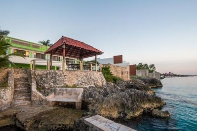 Seaside palapa sits right on the water and has a dining table and chairs