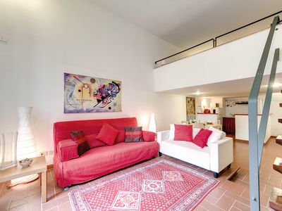 Photo for Charming apartment in a medieval building in the heart of Trastevere with a nice balcony .
